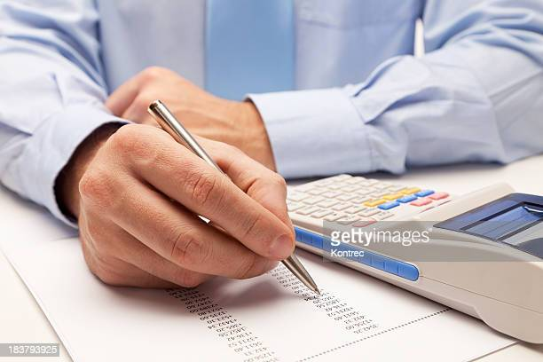 Male accountant calculating taxes