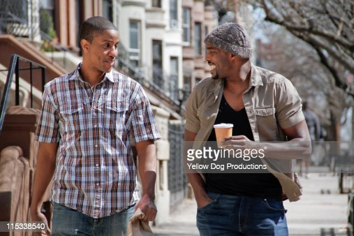Male Adult Friends Walking Down City Street : Stock Photo