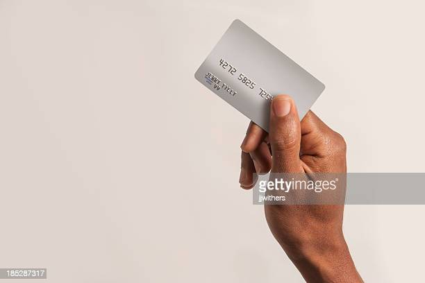 Male African American hand holding fake credit card