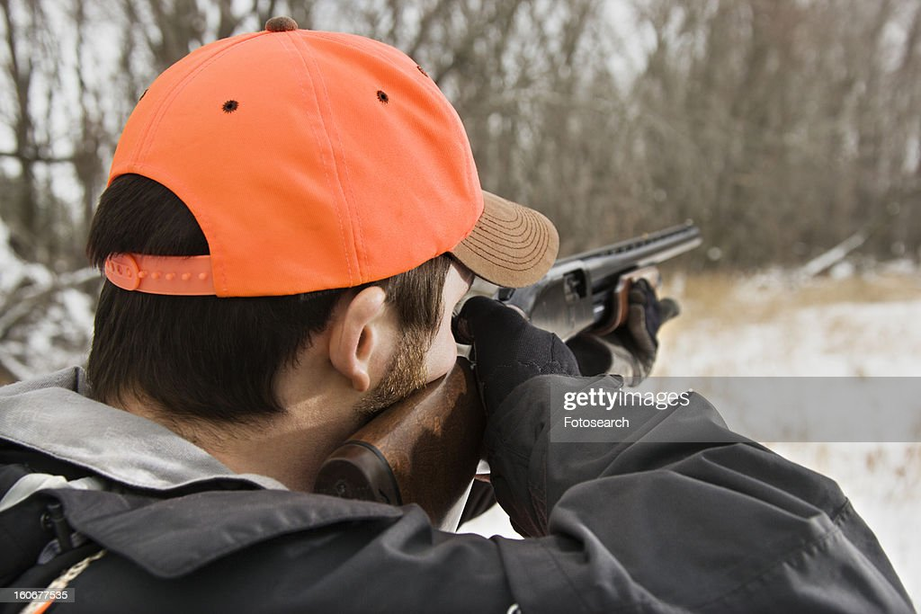 Male Aiming Shotgun Towards Woods Stock Photo | Getty Images