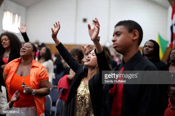 Male and female church congregants pray and sing Gospel tunes during a worship service at the True Love Worship Center in Van Nuys CA on Sunday July...