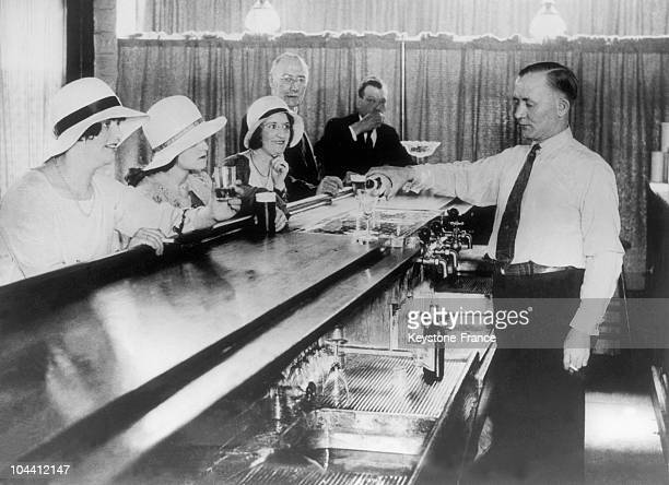 Male and female clients of a NewYork speakeasy around 1930 These illegal bars which developed during the period of American Prohibition were...