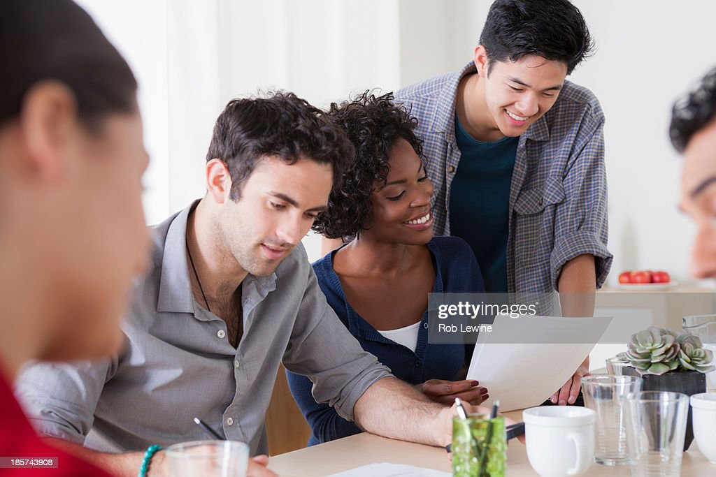 Male and female colleagues meeting in office : Stock Photo