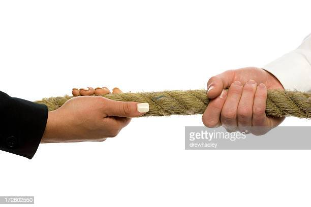 Male and female hands grasping rope. Tug-O-War.