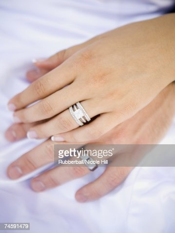 male and female hands with wedding rings stock photo - Female Wedding Rings