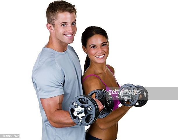 Male and female lifting weights