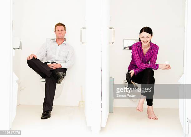 Male and female relax in toilets