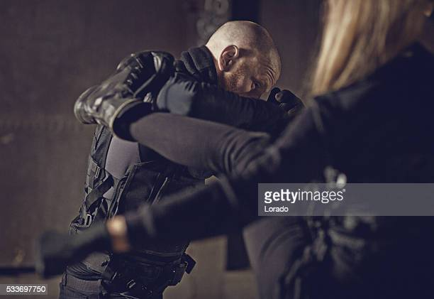 Male and female swat team members fighting in urban setting