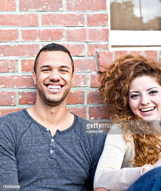 Male and female teens laughing together