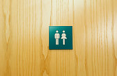Male and female toilet sign on door