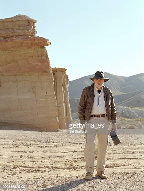 Male archaeologist in desert, portrait