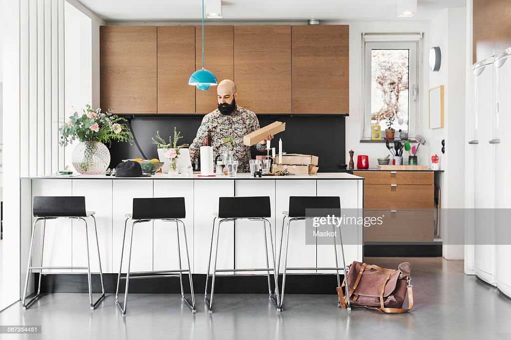 Male Architect Working At Kitchen Island : Stock Photo