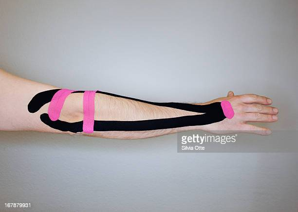 male arm with kinesiology tape