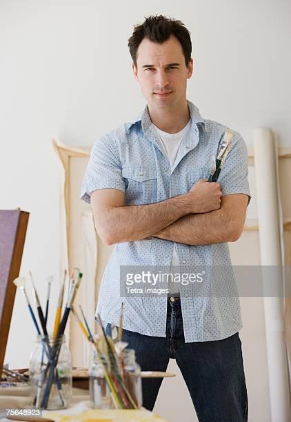 Male artist in painting studio