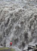 Male at edge, Dettifoss Waterfall