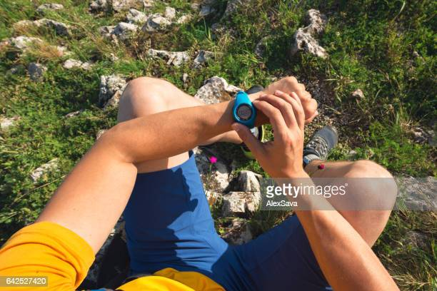 Male athlete checking his stopwatch after his workout