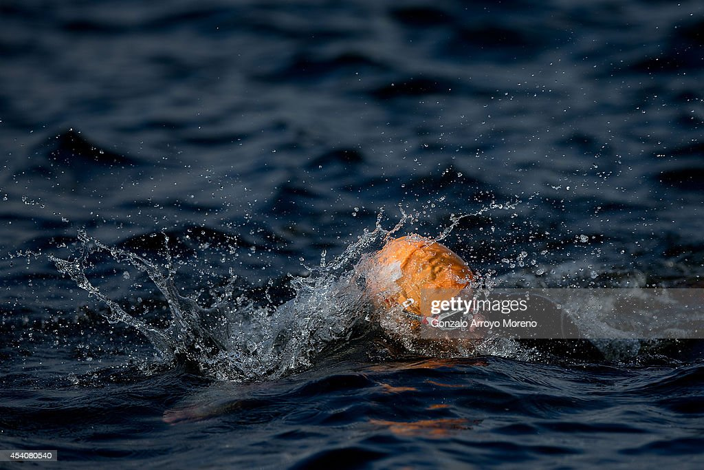 A male athlete competes on the swimming course of one of the Age Groupers Wave Race during the ITU World Trathlon on August 24, 2014 in Stockholm, Sweden.