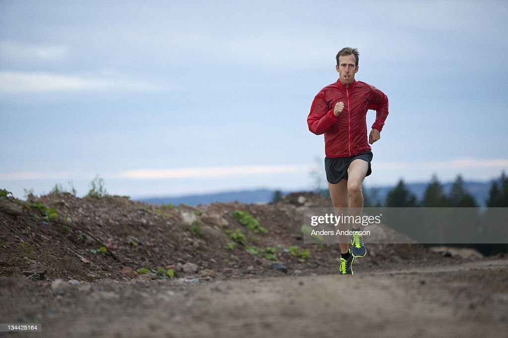 Male athlete cross country runner training : Stock Photo