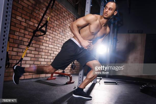 Male athlete doing stretching exercises. Mielec, Poland