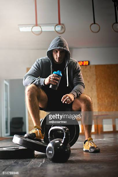 Male athlete enjoys delicious health drink