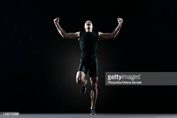 Male athlete flexing arms and shouting