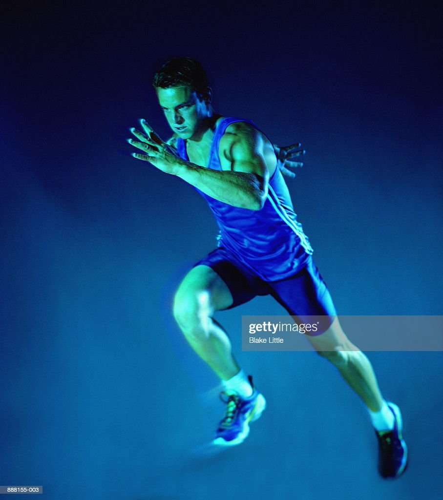 Male athlete in action : Stock Photo