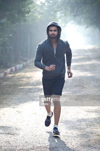 Male athlete jogging at park