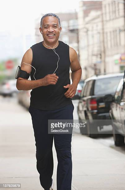 Male athlete jogging through the streets