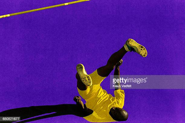 Male athlete landing after highjump