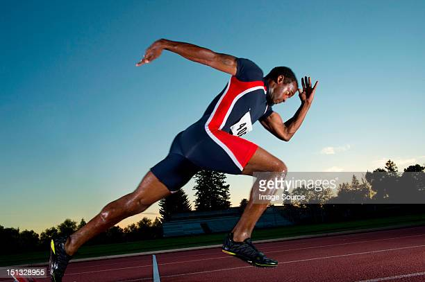 Male athlete leaving starting blocks