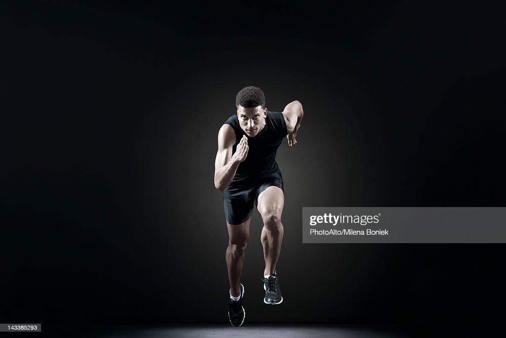 Male athlete leaving starting line