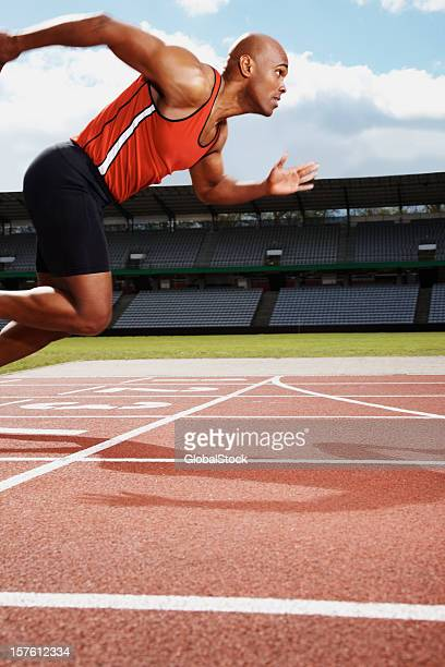 Male athlete on starting line of running track