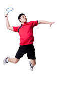 Male athlete playing badminton