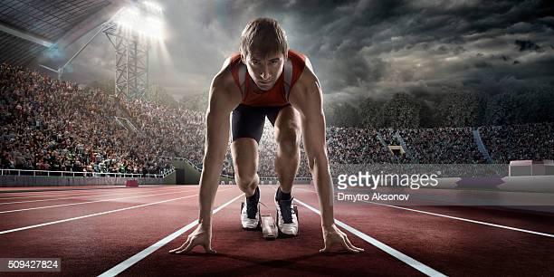 Male athlete prepares to run