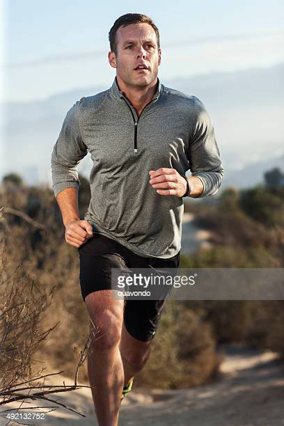 Male Athlete Running On Outdoor Trail