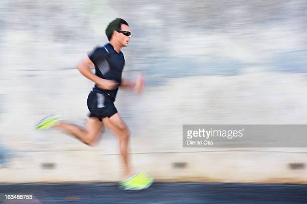 Male athlete running with motion blur