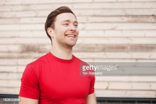 Male athlete smiling.