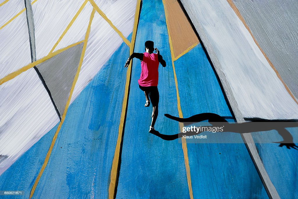 Male athlete sprinting, shot from above : Stock Photo