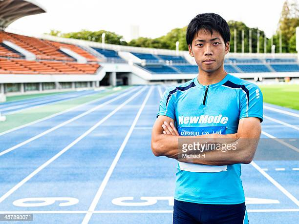 male athlete stands in the stadium