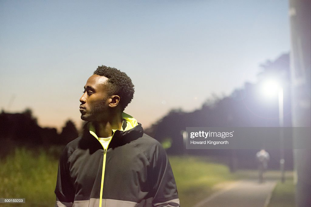 male athlete, urban setting at night : Stock Photo