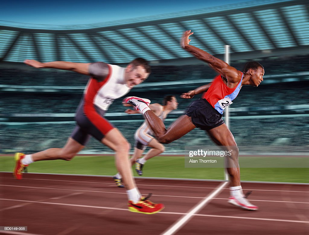 Male athletes at finishing line, winner crossing line (Composite) : Stock Photo