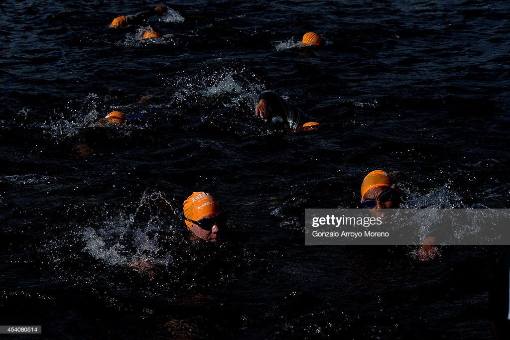 Male athletes compete on the swimming course of one of the Age Groupers Wave Race during the ITU World Trathlon on August 24, 2014 in Stockholm, Sweden.