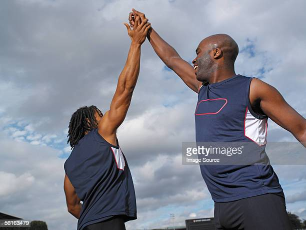 Male athletes high five