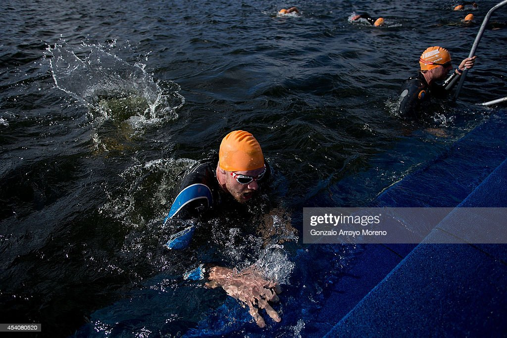 Male athletes leave the water at the end of the swimming course of one of the Age Groupers Wave Race during the ITU World Trathlon on August 24, 2014 in Stockholm, Sweden.