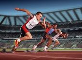 Male athletes leaving starting blocks (Digital Composite)