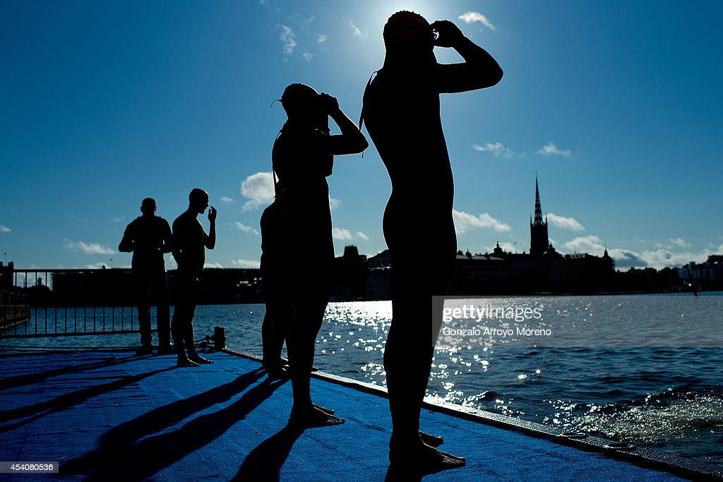 Male athletes wear their swimming glases prior to start the swimming course of one of the Age Groupers Wave Race during the ITU World Trathlon on August 24, 2014 in Stockholm, Sweden.