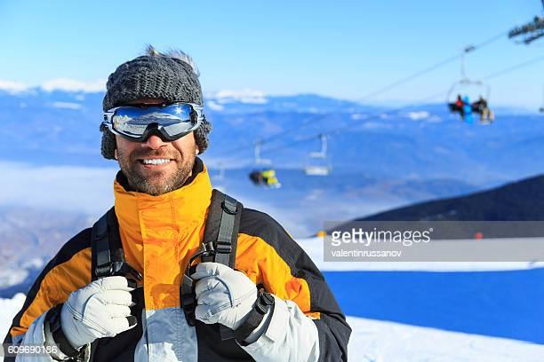 Male backpacker hiking in ski resort