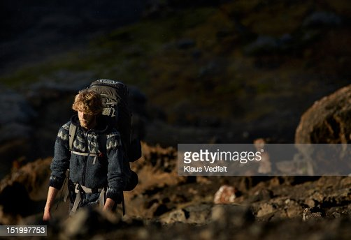 Male backpacker on mountain hike : Stock Photo
