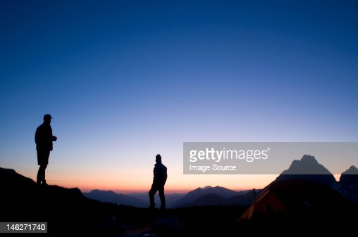 Male backpackers at camp in evening, Kool Aid Lake, Ptarmigan Traverse, North Cascades, Washington, USA : ストックフォト