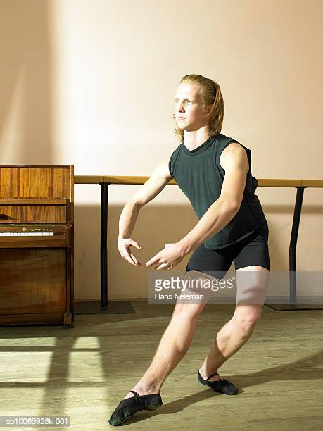 Male ballet dancer (14-15) rehearsing in dance studio